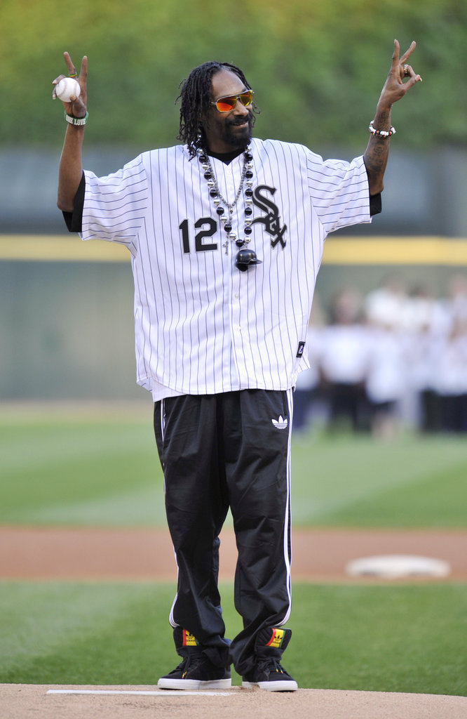 Snoop Lion threw up a peace sign before the first pitch at the Chicago White Sox game in May 2012.