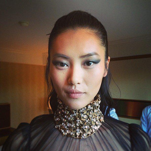 We fell in love with Liu Wen's makeup and jeweled collar. Source: Instagram user esteelauder