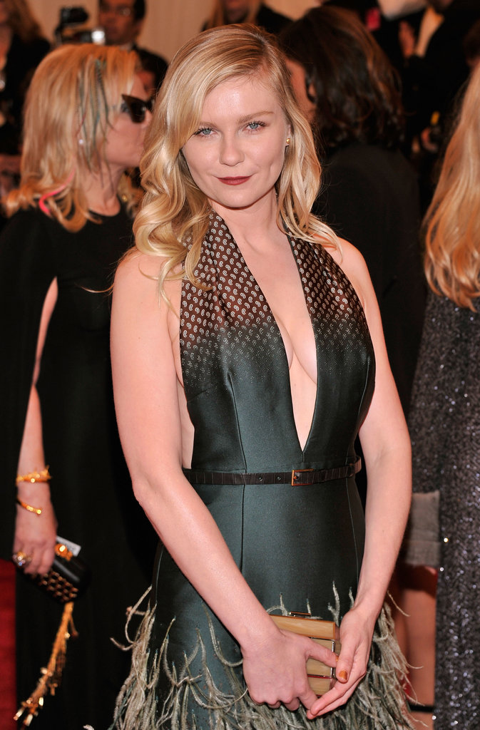 Kirsten Dunst went with a more classic look with beachy waves and a simple red lipstick at the Met Gala.