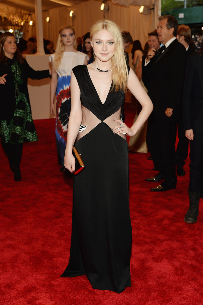 Dakota Fanning's black Rodarte gown featured sheer panels and a plunging neckline.
