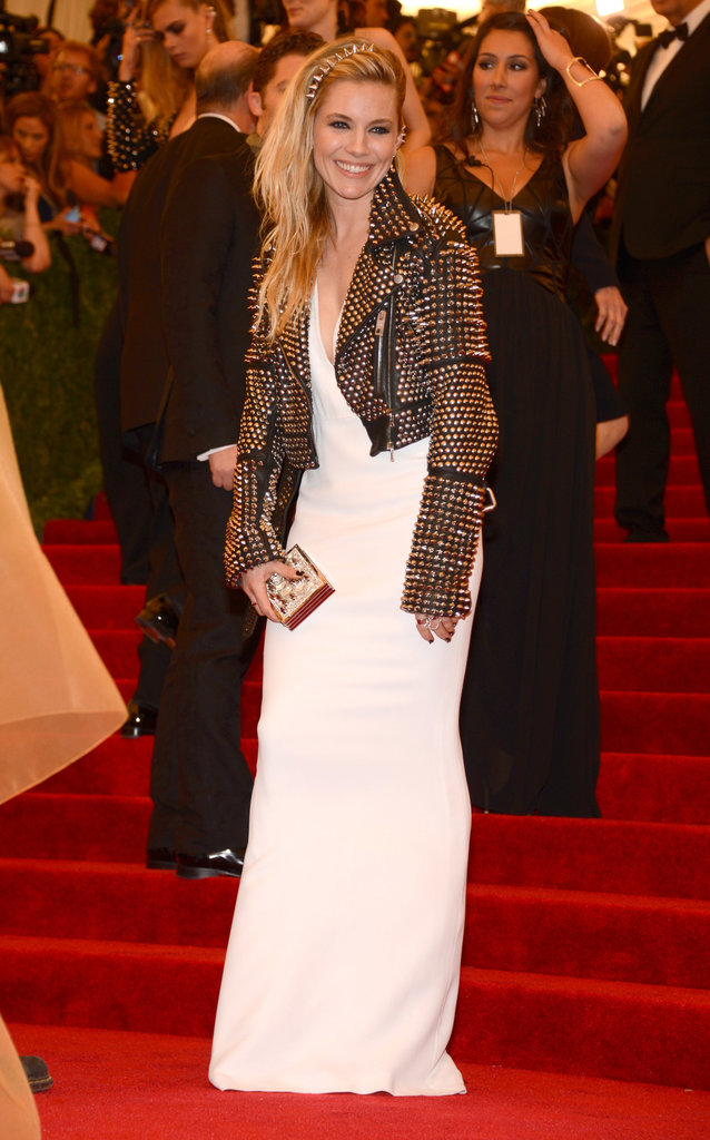 Sienna Miller played the punk mum in a studded leather jacket and spike hair accessory.
