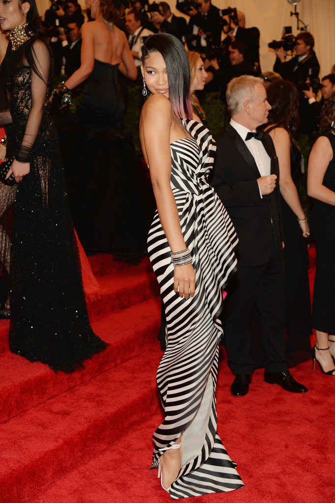 Chanel Iman posed for the cameras in a black-and-white striped J. Mendel gown, a pink Christian Louboutin clutch, and Lorraine Schwartz jewels.
