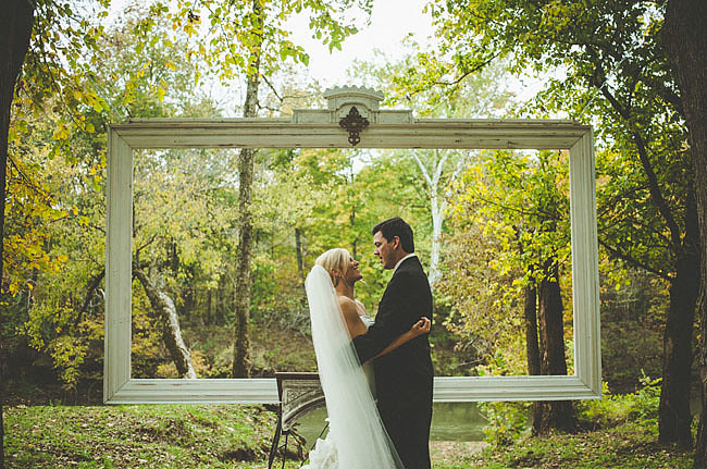 There's not much to this backdrop other than one giant frame, but it's chic and simple, which makes it appropriate for both ceremony and photo booth.  Photo by Alec Vanderboom Photography via Green Wedding Shoes