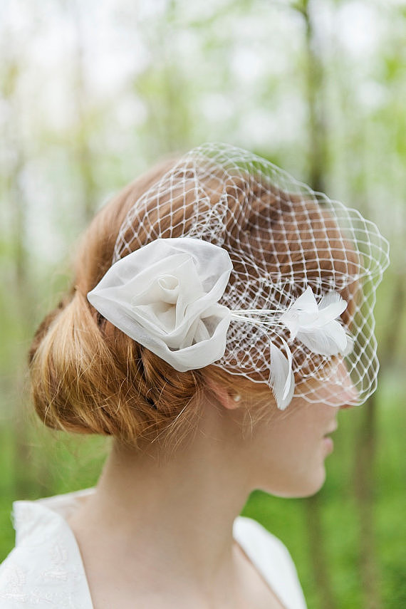 Add some vintage flair to your hair with a rose headpiece ($128), complete with a sweet birdcage veil.