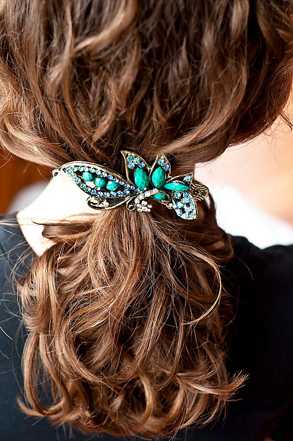 Wear your something blue in your hair with a vintage turquoise flower jeweled hair clip ($20).