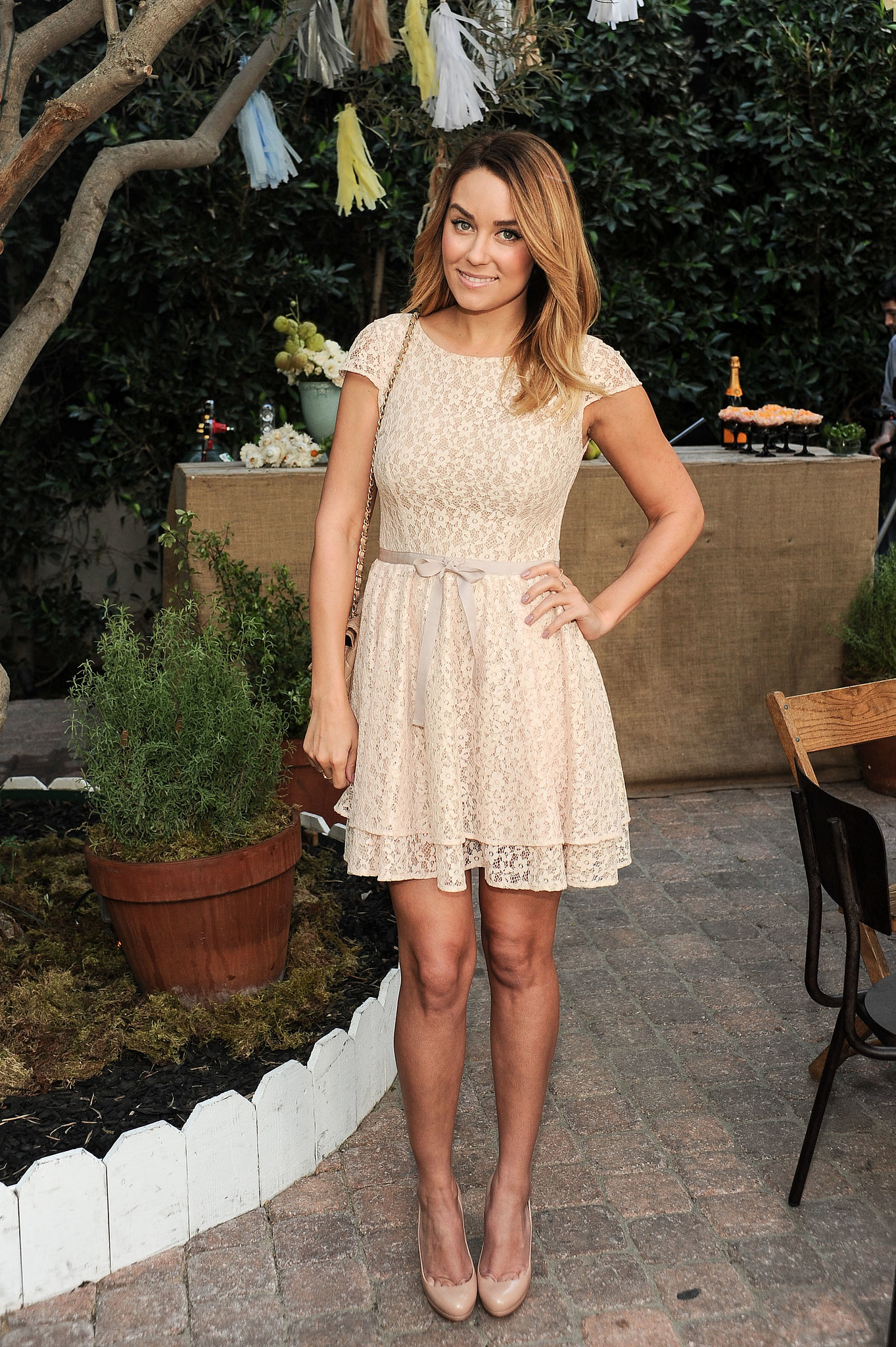 For a ShoeMint event in 2012, Lauren wore a cream-colored lace dress with her beloved nude Christian Louboutins. Lesson from Lauren: get a double dose of sweetness with a lace mini and bow belt.