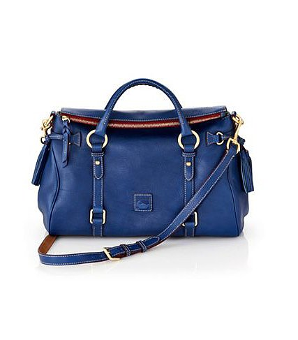 If you're on the market for a bag to wear every day of the week, try a roomy satchel with a top handle and a longer removable strap. Put your own spin on it by opting for bold blue like this Dooney & Bourke pick ($398).