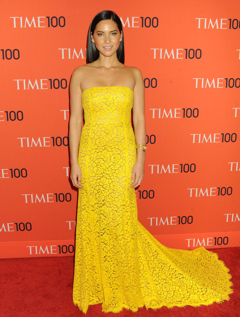 Olivia Munn's yellow lace Michael Kors gown melded timeless (lace) with sassy (yellow) at the Time 100 gala in NYC — we think this style would be perfect for a traditional wedding that welcomes a touch of modern.