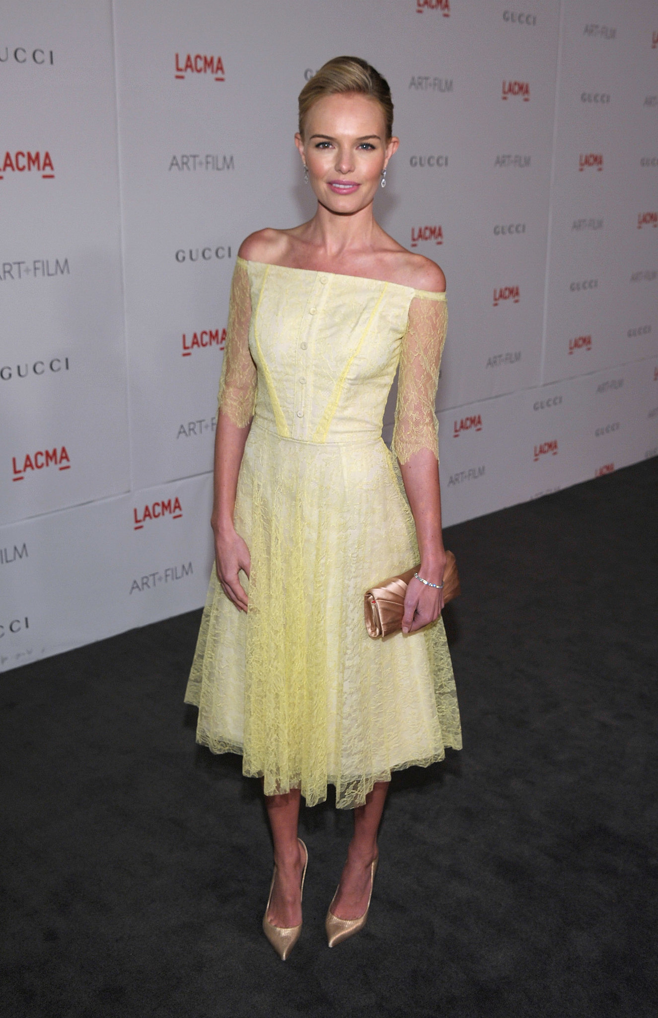 Kate Bosworth s pale yellow lace midi length dress and