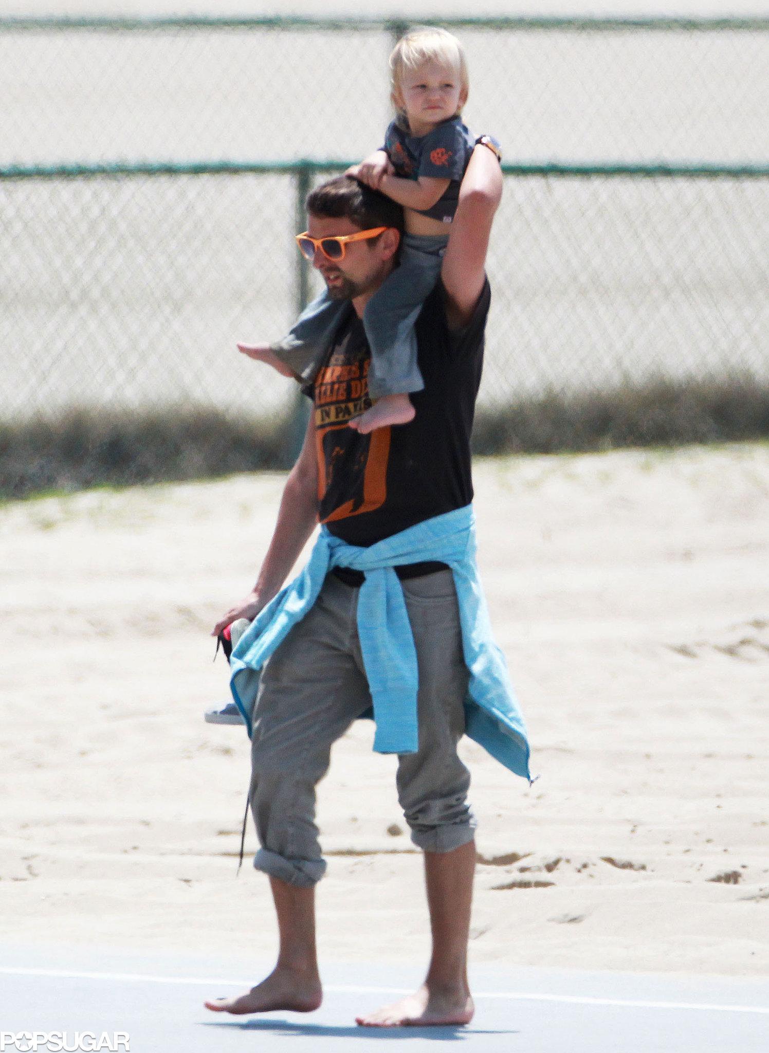 Matthew Bellamy carried his son Bing in Santa Monica.