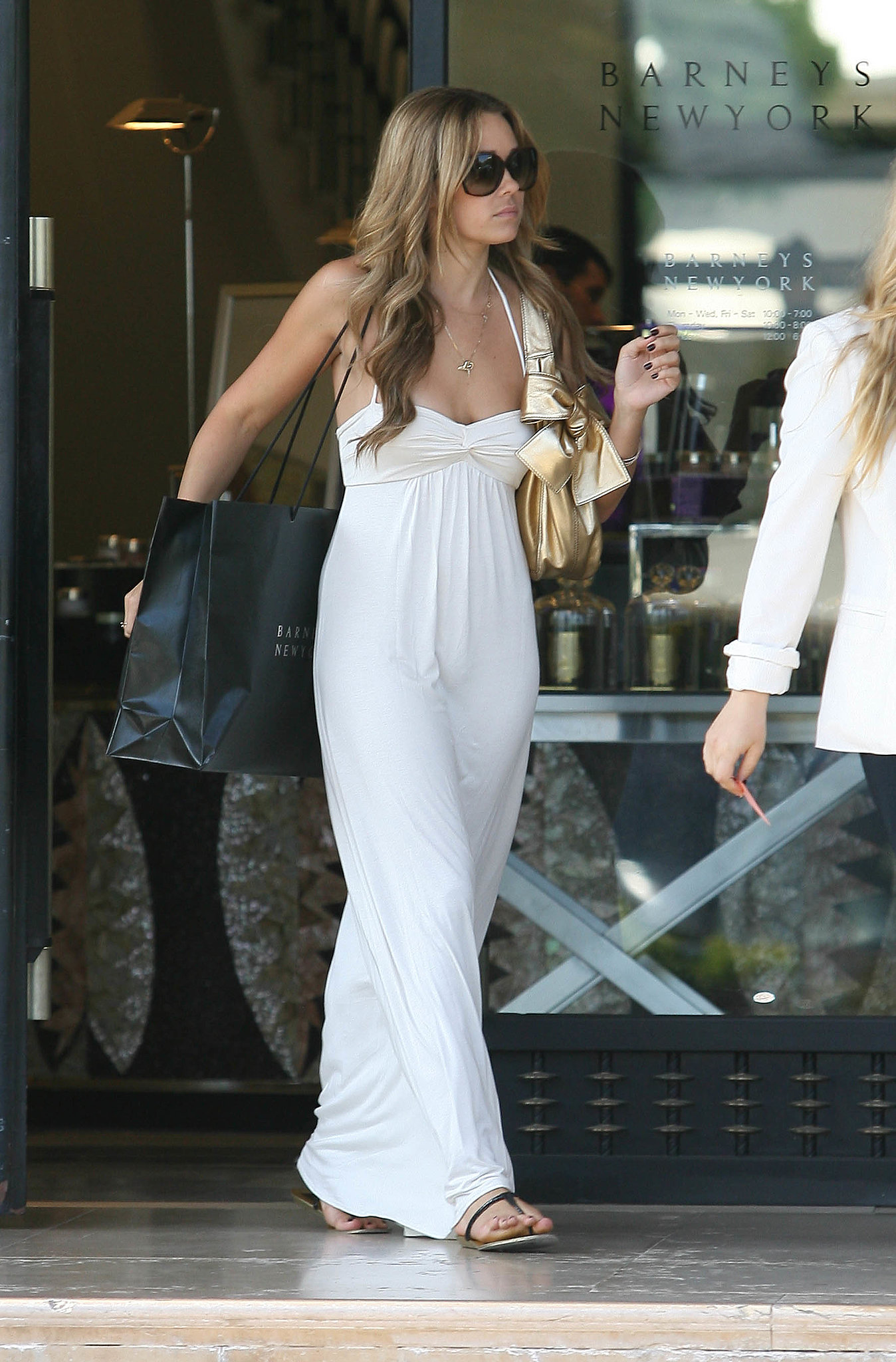 During a 2008 LA shopping spree, LC went back to basics in a white maxi dress and black sandals. Lesson from Lauren: steer clear of the bride vibe by keeping your white maxi simple.