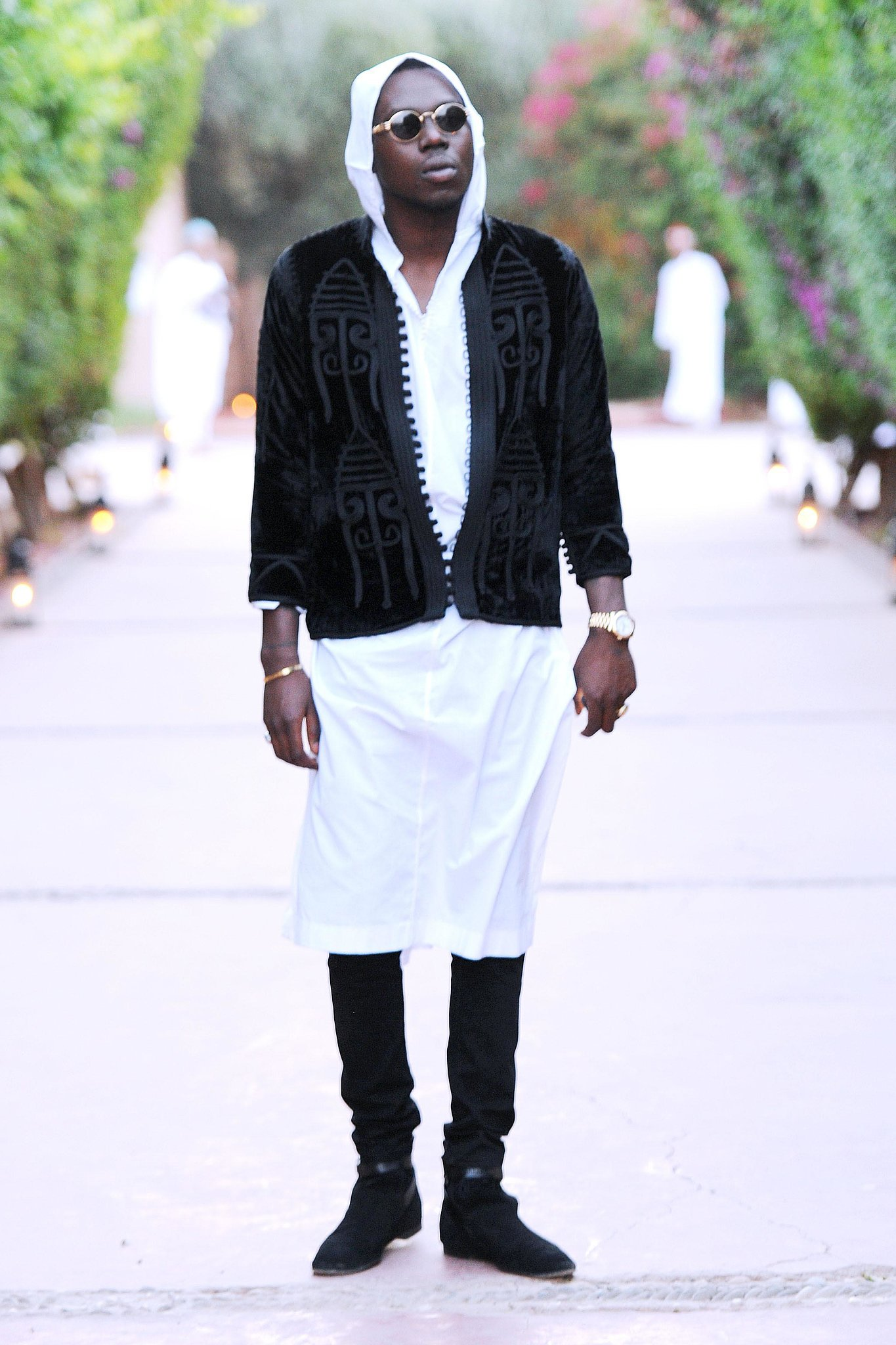Theophilus london played with layers by wearing a knee length white see how the glossy set Theophilus london fashion style