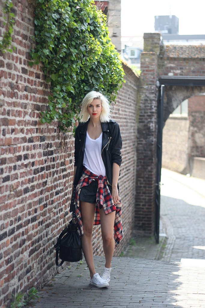 Channeling the '90s is easy with a little help from a well-placed plaid shirt, a leather jacket, and a pair of Converse. Source: Lookbook.nu