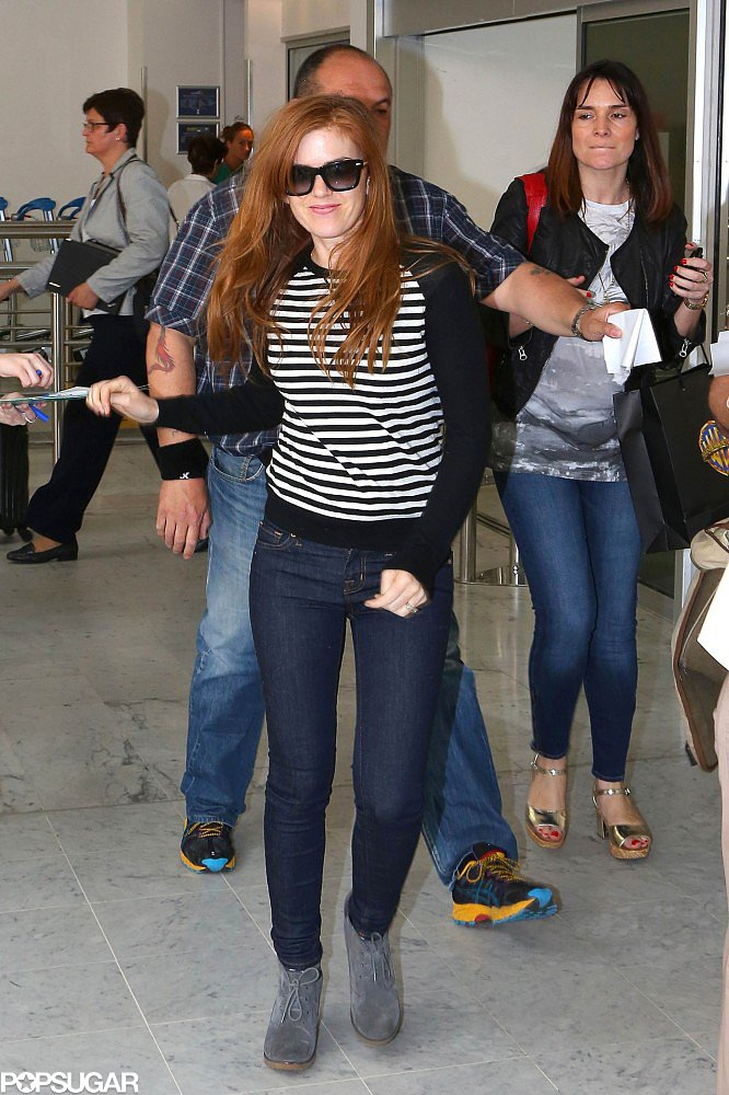 Isla Fisher signed autographs upon her arrival in Nice, France, on Tuesday for the Cannes Film Festival.