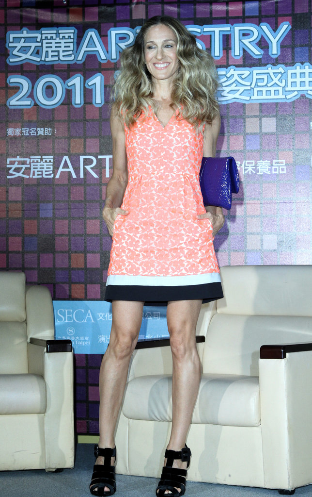 Sarah Jessica Parker oozed youth and charm in a neon orange minidress and suede caged sandals for a Taiwan press conference in July 2011.