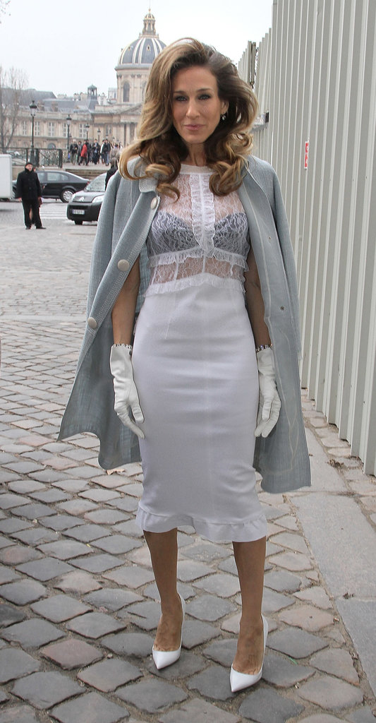 SJP channeled her inner seductress, layering a white lace-bodice Louis Vuitton creation, complete with matching gloves and pointed pumps, over a black bra during Paris Fashion Week in March 2012.