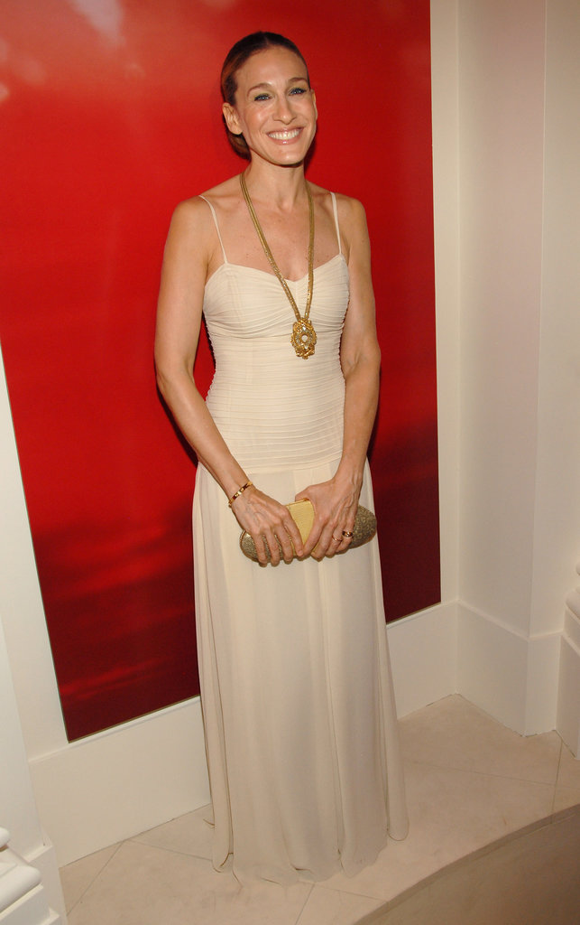 Sarah Jessica Parker's dazzling gold pendant, Cartier bangle, and dual-textured oval clutch adorned her sleek nude gown perfectly.