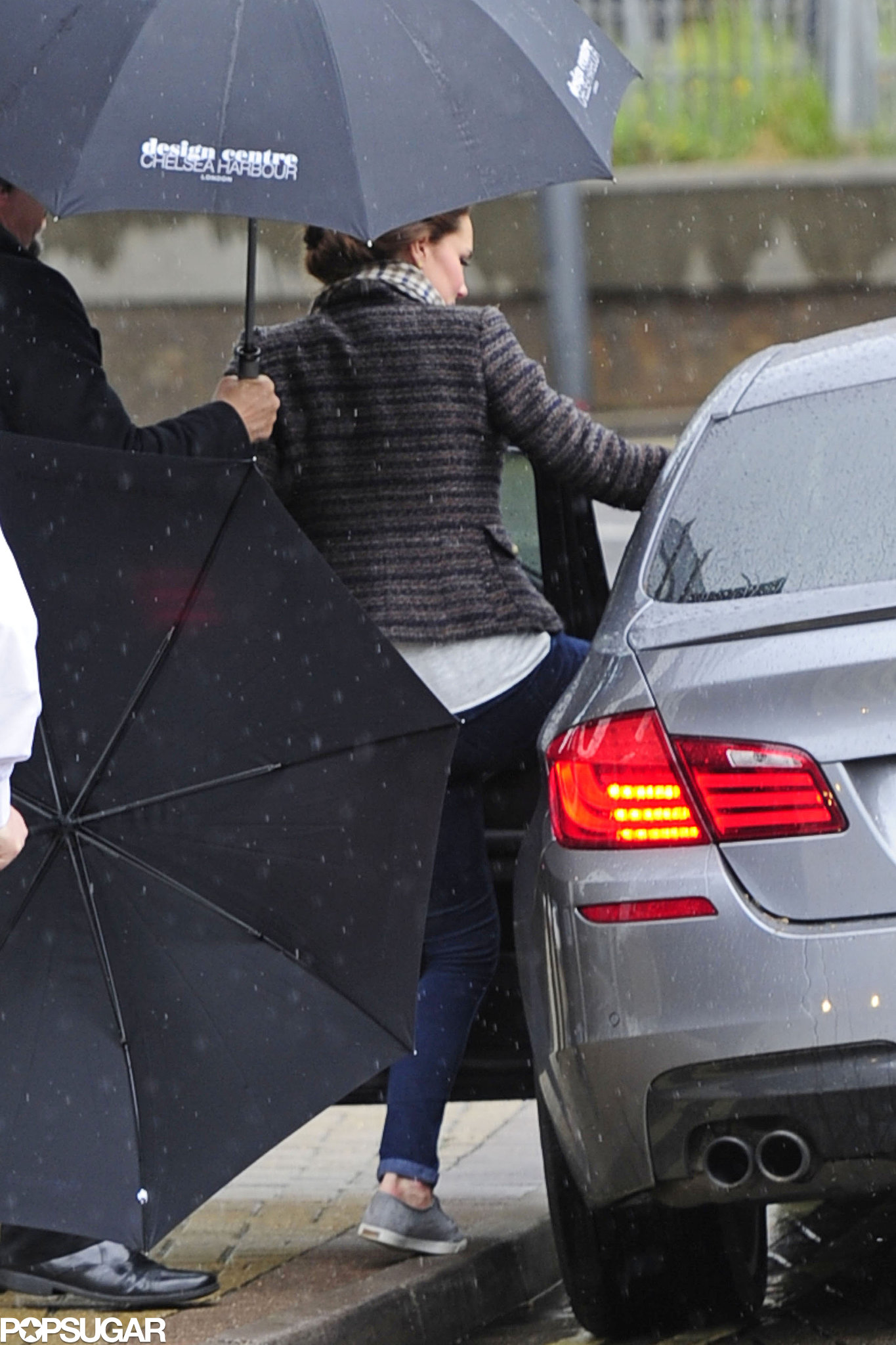 Pregnant Kate Middleton wore jeans and sneakers for a rainy day shopping trip in London.