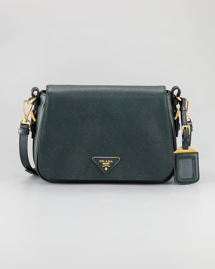 A luxurious bag for day is a key part of any work ensemble. We love that this classic Prada shape ($1,495) differentiaties itself in a deep forest green.
