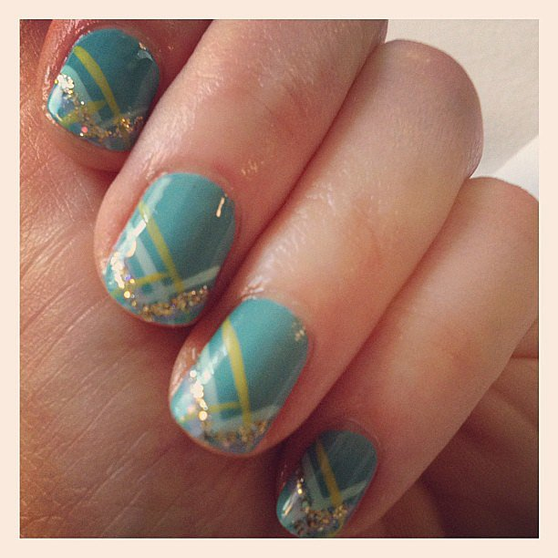 For this crisscross design, Zooey pulled in blues, greens, and glitter for a Spring-inspired manicure.  Source: Instagram user ZooeyDeschanel
