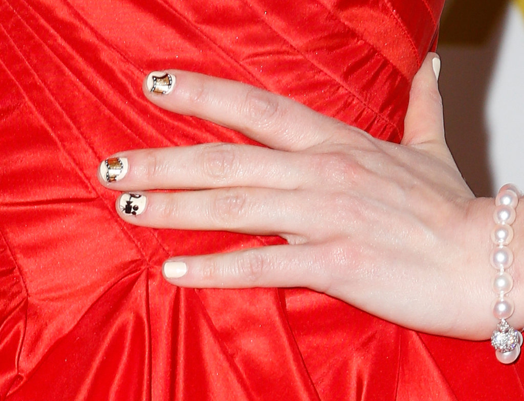 Zooey embraced the film theme at the 2013 Golden Globes with a movie reel manicure designed by none other than Tom Bachik.
