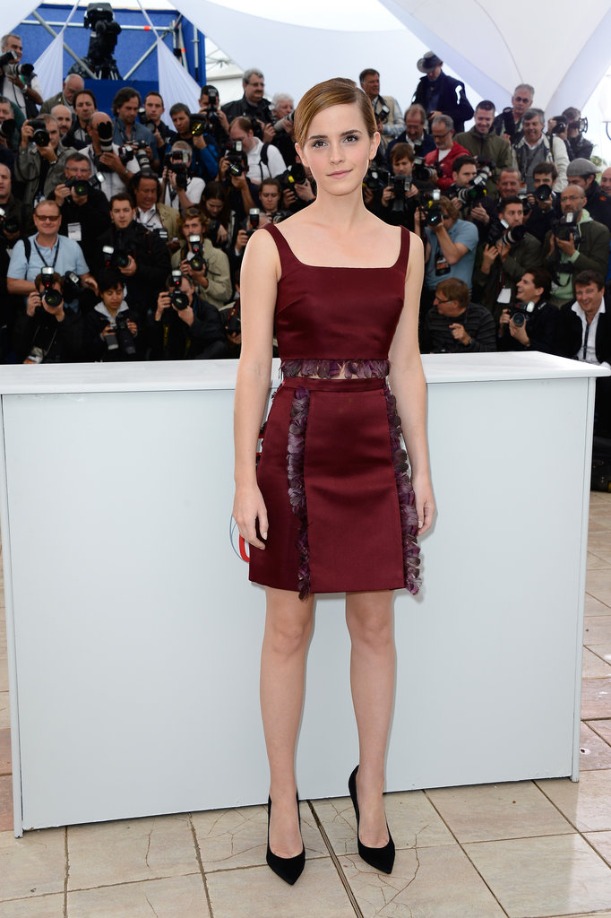 Emma Watson looked all grown-up posing at the Bling Ring photocall in a rich, burgundy-hued, feather-trimmed crop-top-and-skirt set from the Fall '13 Christoper Kane collection, which she finished with classic black Gianvito Rossi pumps.
