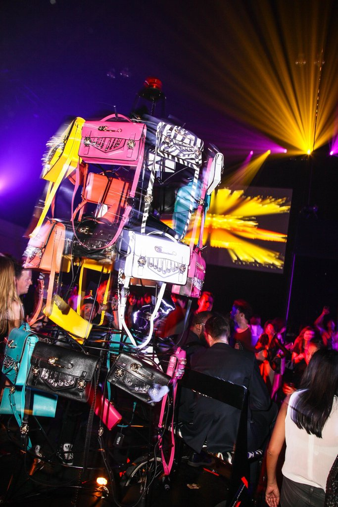 A handbag carousel, which was driven around by a model on a bicycle, at the JW Anderson for Versus Versace launch party. Source: Matteo Prandoni/BFAnyc.com