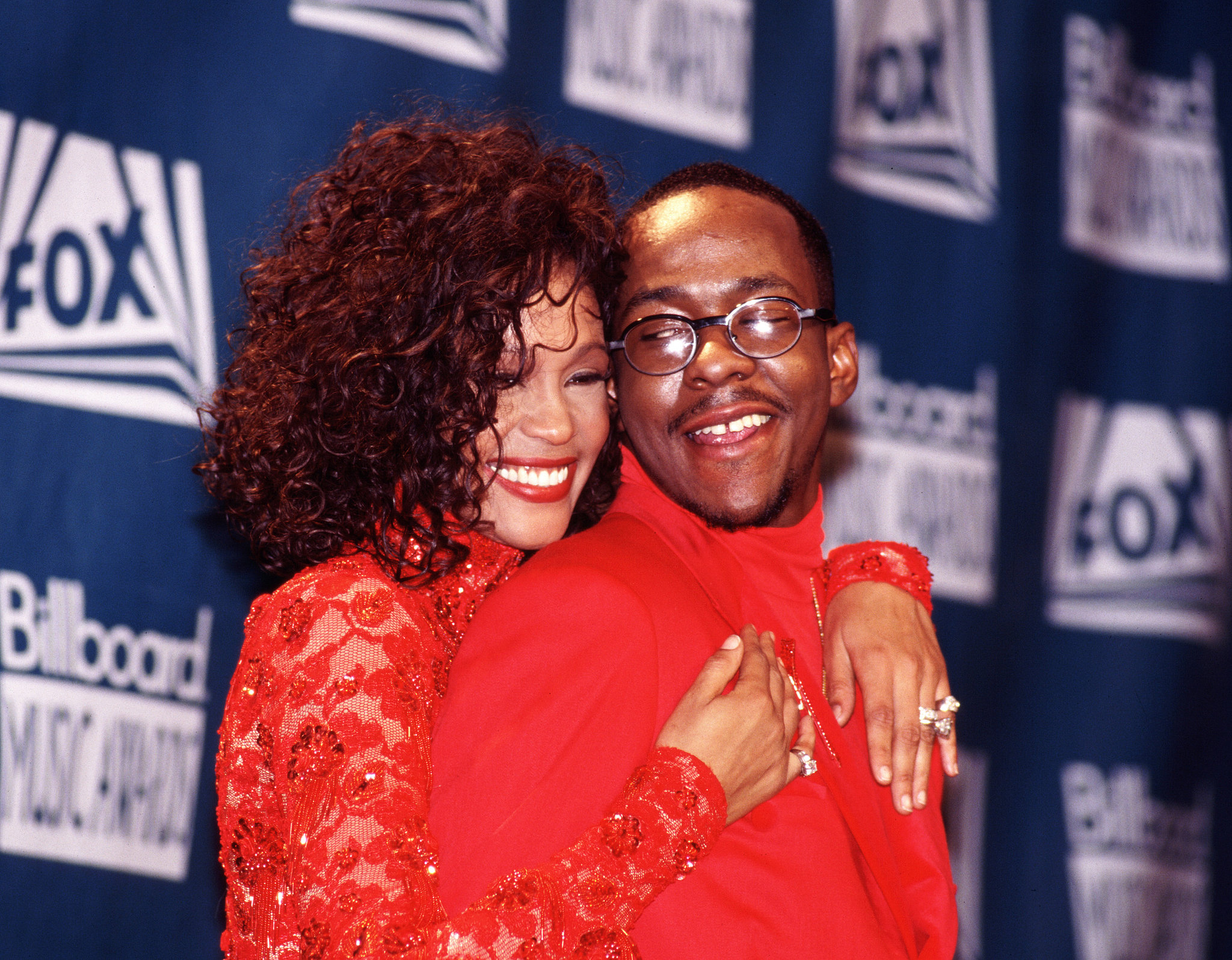 Whitney Houston and Bobby Brown snuggled up backstage in December 1993 for the Billboard Music Awards.