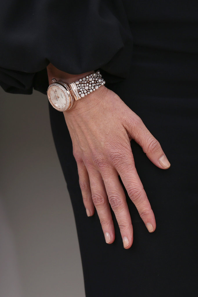 Thank goodness for zoom! The pearl and diamond details on Nicole's feminine watch were too pretty to miss.