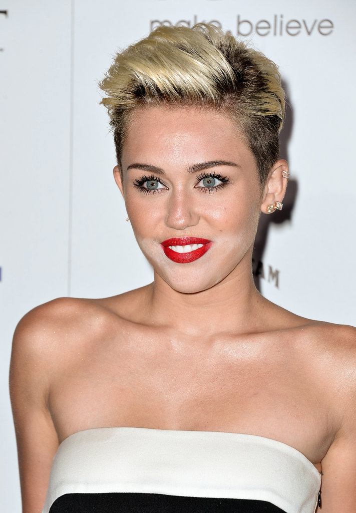 Miley Cyrus was at the Maxim Hot 100 party celebrating her No. 1 ranking. She wore her hair in a slicked-back pompadour with classic red lips and plenty of mascara.