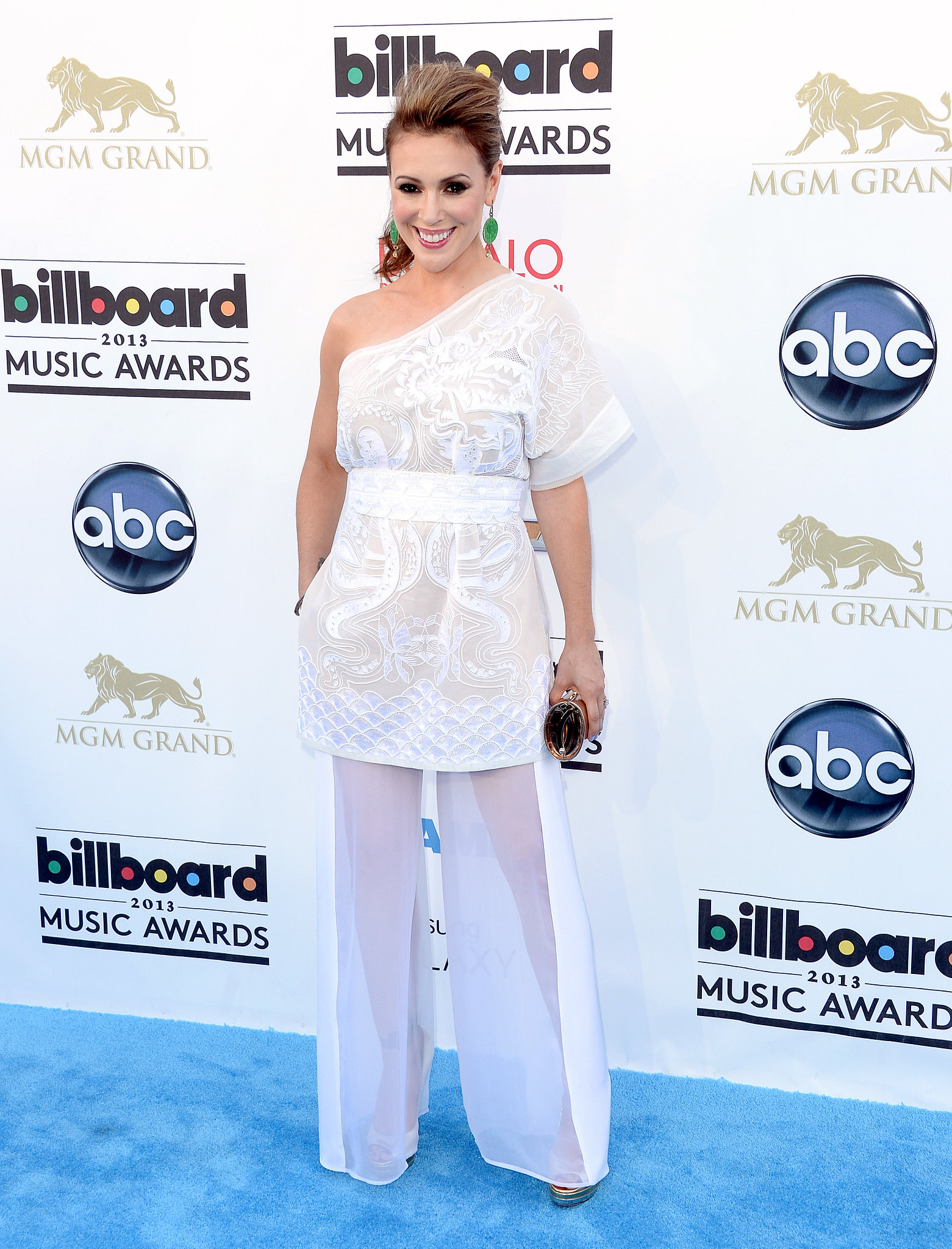 Alyssa Milano went with all-white in a one-shouldered tunic, complete with sheer wide-leg trousers.
