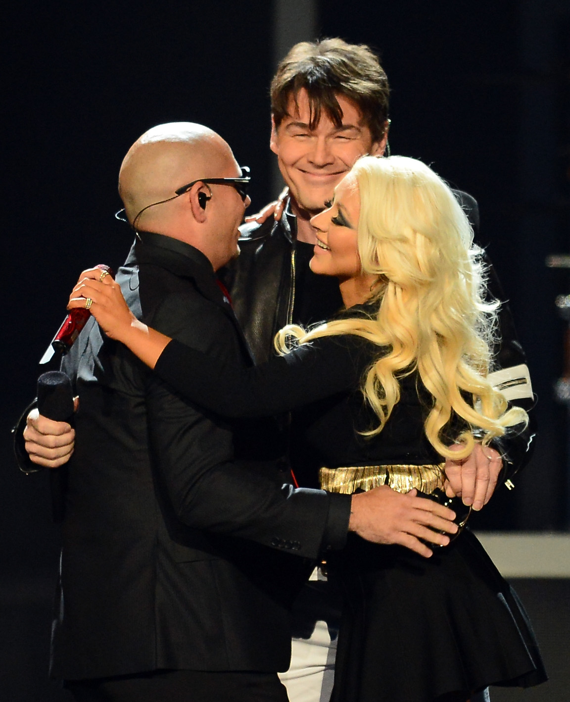 Christina Aguilera, Pitbull, and Morten Harket hugged it out.