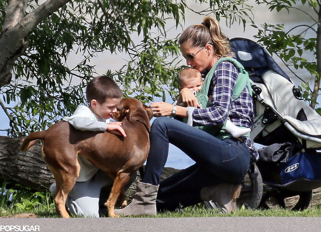 Gisele Bündchen cuddled her baby girl, Vivian Brady, while hanging with Jack Brady and her dog in Boston.