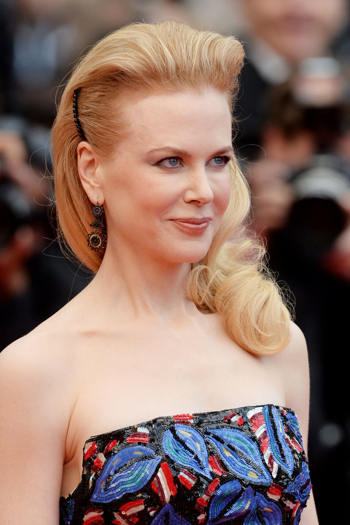 Nicole Kidman styled her hair into a gorgeously voluminous 'do, complete with curls and black barrettes. This is a great option for the bride who don't want to be bothered with hair on her face.