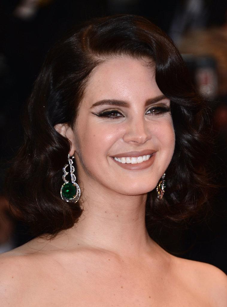 Lana Del Rey wore large Chopard earrings.