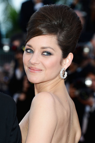 Also at the Blood Ties premiere, Marion Cotillard opted for a beehive hairstyle that was high on volume. She kept her makeup classic with a blue smoky eye.