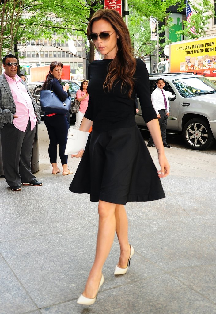 Victoria Beckham gave her little black dress a majorly fresh spin via white Casadei pumps and a white envelope clutch.