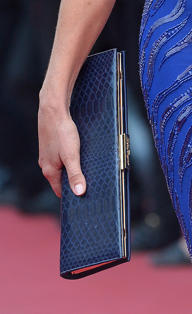 Sharon Stone carried a navy-blue snakeskin clutch.