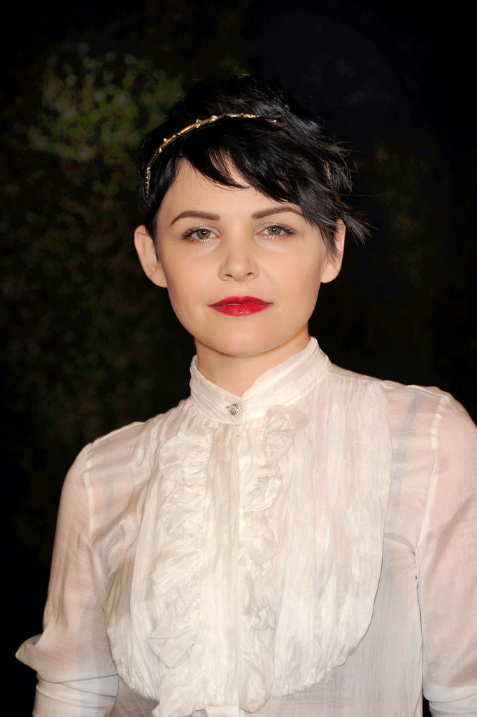 While at times Ginnifer walks the line of extreme beauty, she opted for a more ladylike look in a golden headband and crimson lipstick at the Chanel and Charles Finch Pre-Oscar Dinner in 2012.