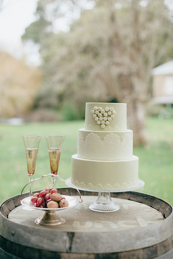 Hearts and lace — does it get any girlier than that? We love the sweet touch this cake adds to the reception.  Photo by Eon Images via Style Me Pretty