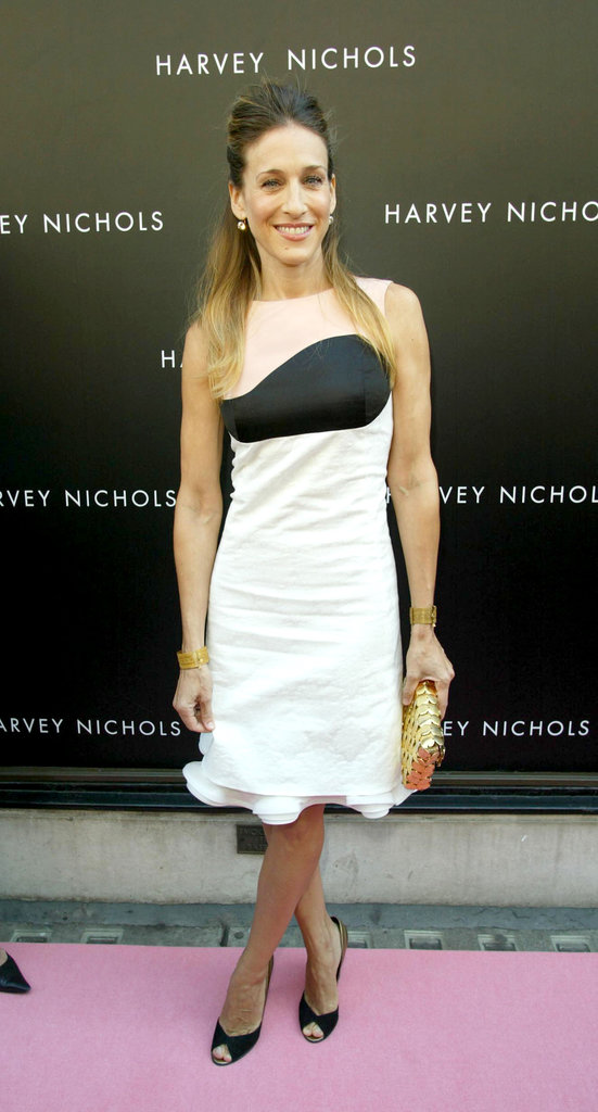 For her August 2005 London fragrance launch, SJP glammed up her Neapolitan dress with gilded gold accessories — a paillette clutch and   dual cuffs.