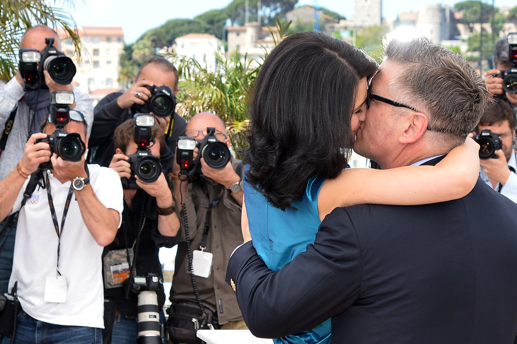 Alec Baldwin and Hilaria Thomas did not mind getting romantic in front of cameras on Monday at the Seduced and Abandoned photocall in Cannes.