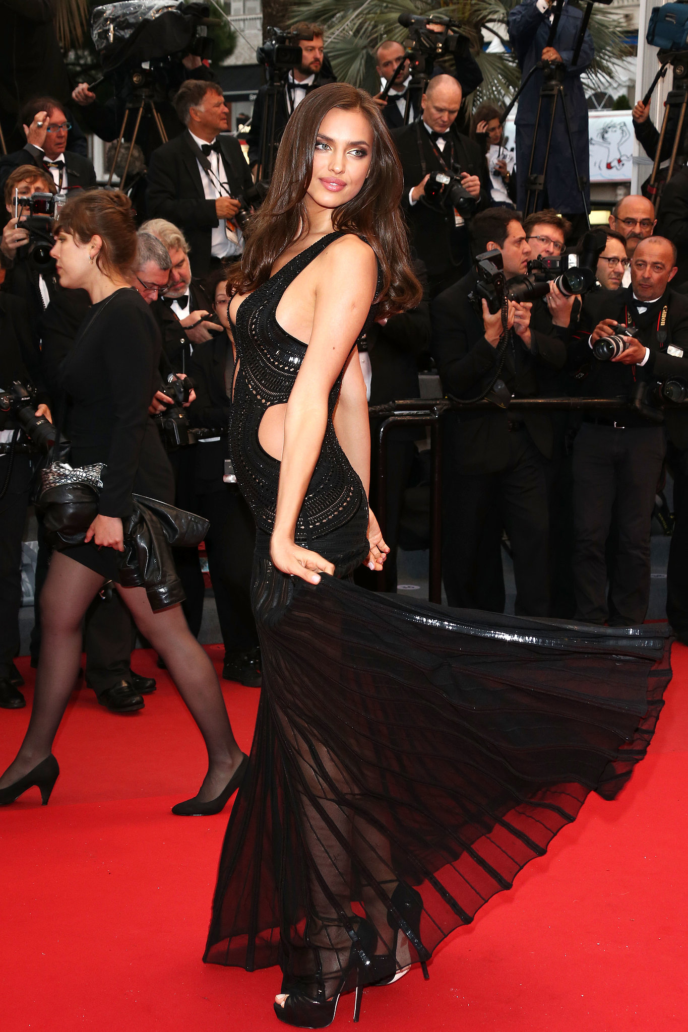Irina Shayk flipped her dress on the red carpet on Wednesday for the All Is Lost premiere.