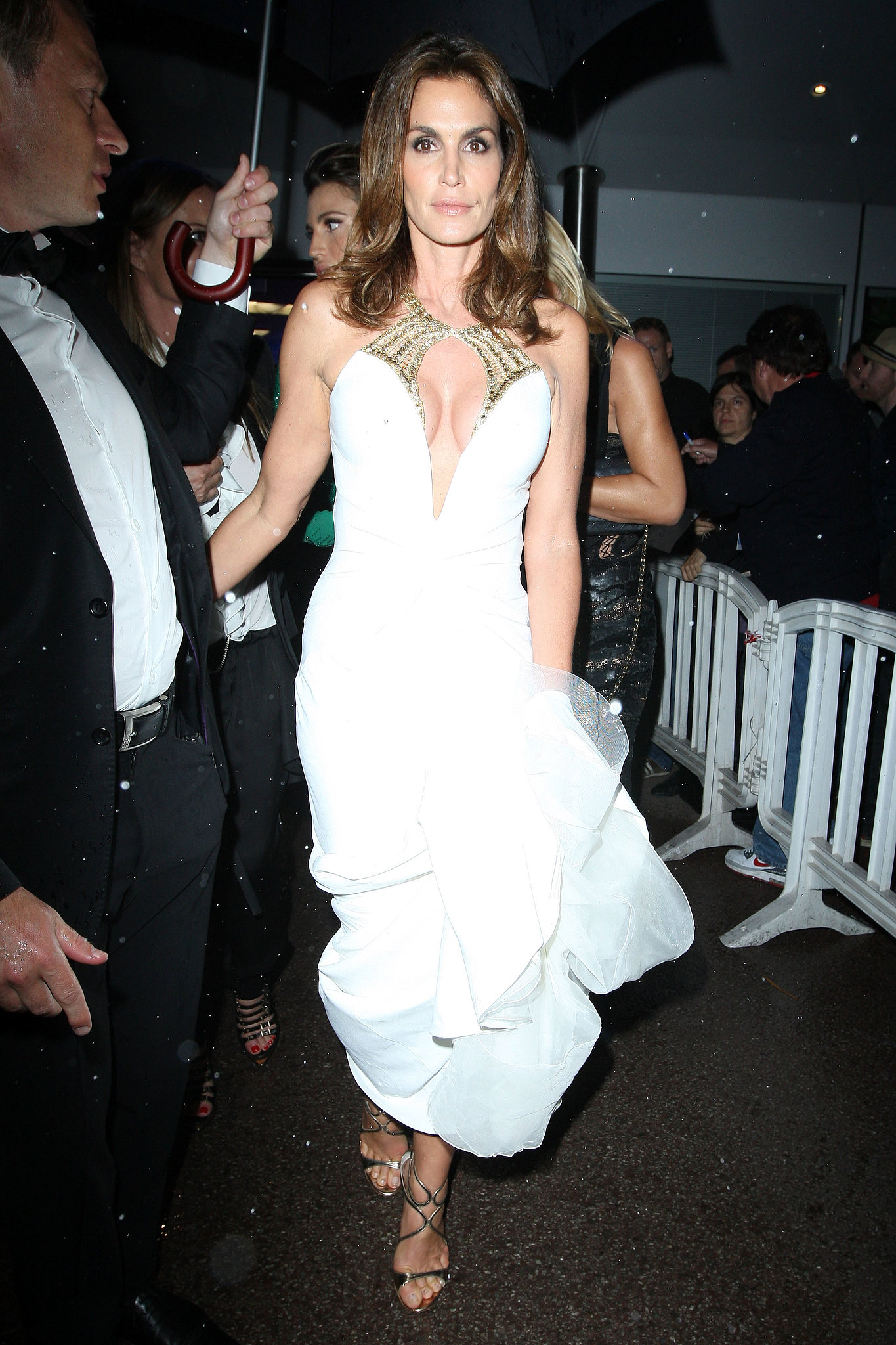 Cindy Crawford brought sexy to the Great Gatsby premiere in Cannes in a white Roberto Cavalli cutout gown with a contrasting gold nec