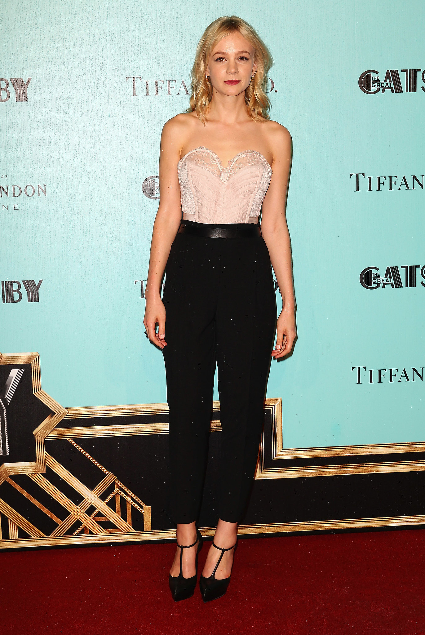 Carey Mulligan tucked a pale pink Nina Ricci bustier top into black trousers at the Great Gatsby premiere in Sydney.