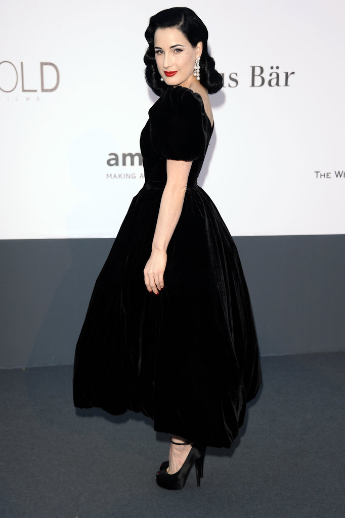 Dita von Teese stuck to her signature fit-and-flare silhouette in a black gown at amfAR's gala, then completed her look with 156 carat Chopard pearl earrings and a bold red lip.