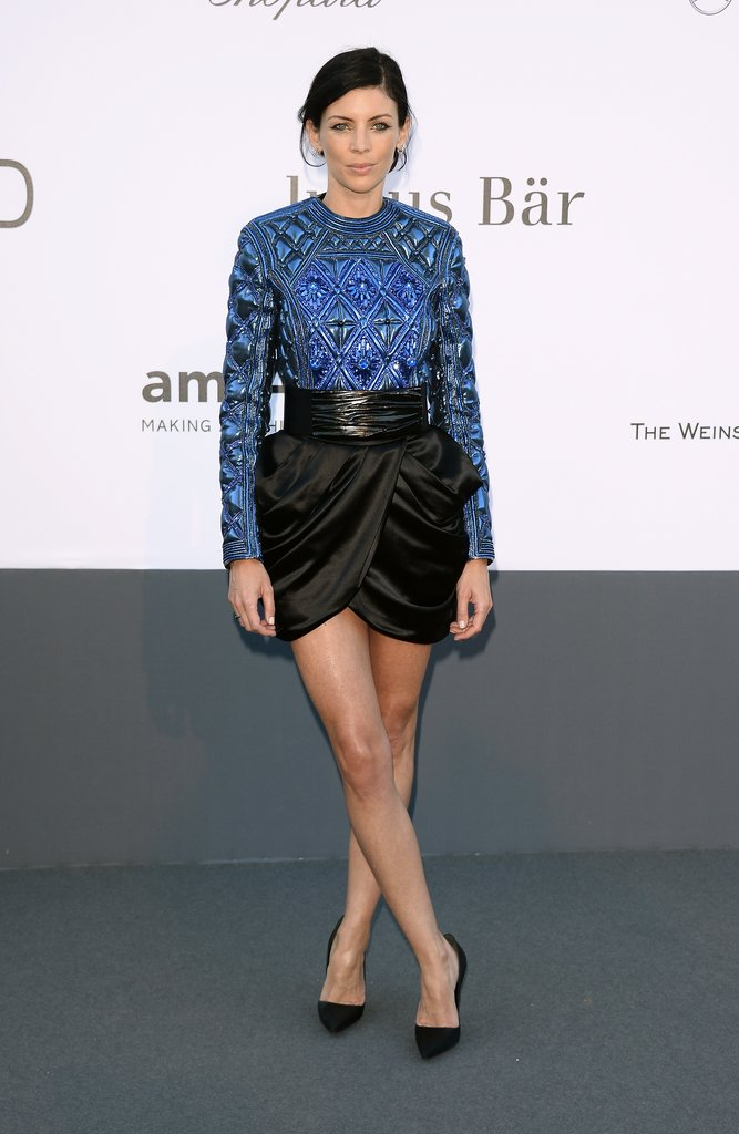 Liberty Ross was fashion-forward in a blue metallic Balmain top and a black silk tulip skirt.