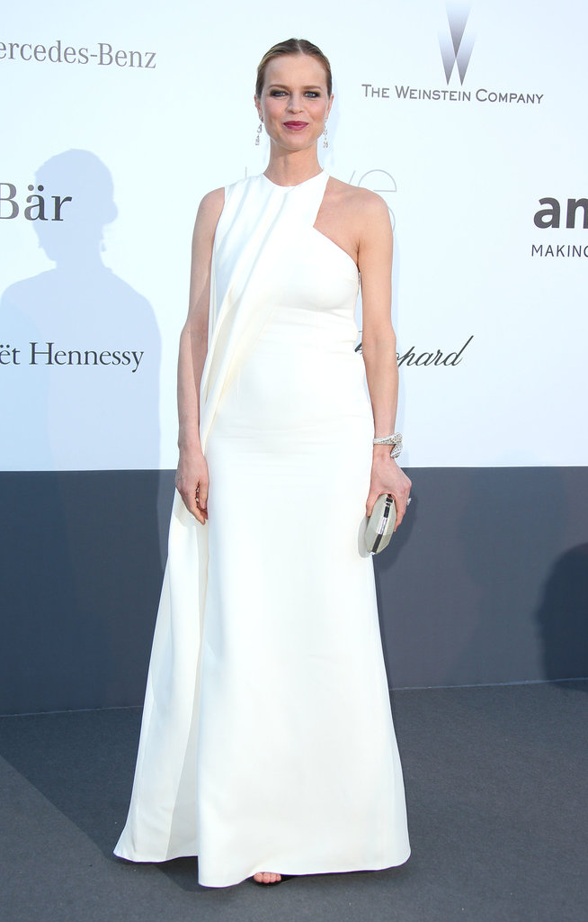 Eva Herzigova was fresh in white in her asymmetrical Dior gown at the amfAR gala.