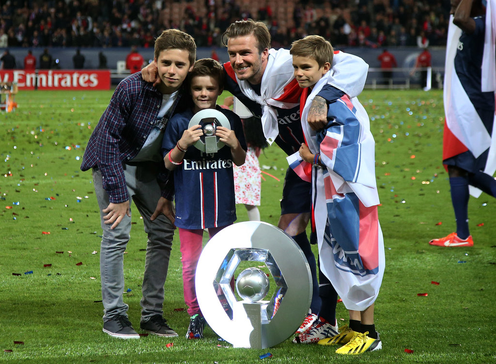 David Beckham's boys left the stands and hit the field to celebrate his last home game with PSG in May 2013.