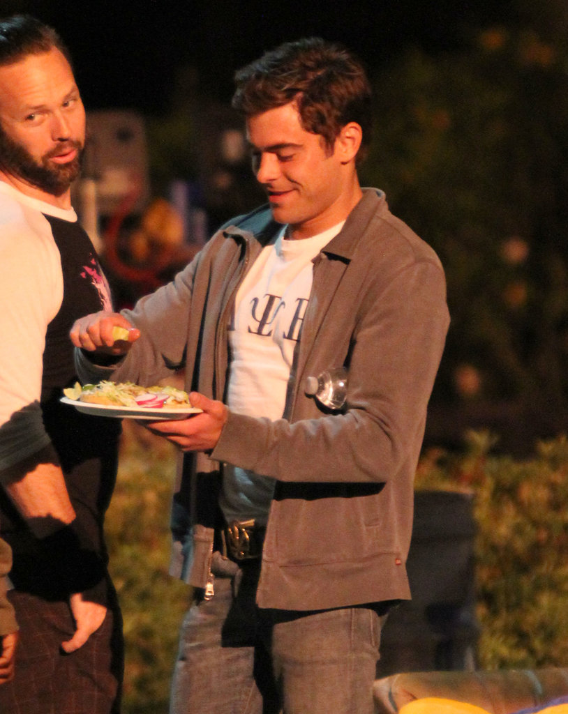 Zac Efron grabbed dinner on set in LA Wednesday night after shooting a scene for Townies in which he got arrested.